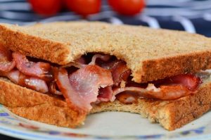 A late night bacon butty: it definitely looks good after several hours dancing.Image by SGM (via Shutterstock).